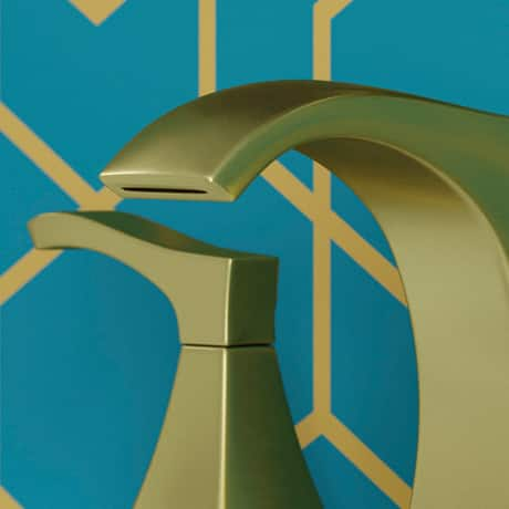 Close up of faucet with wallpaper in background