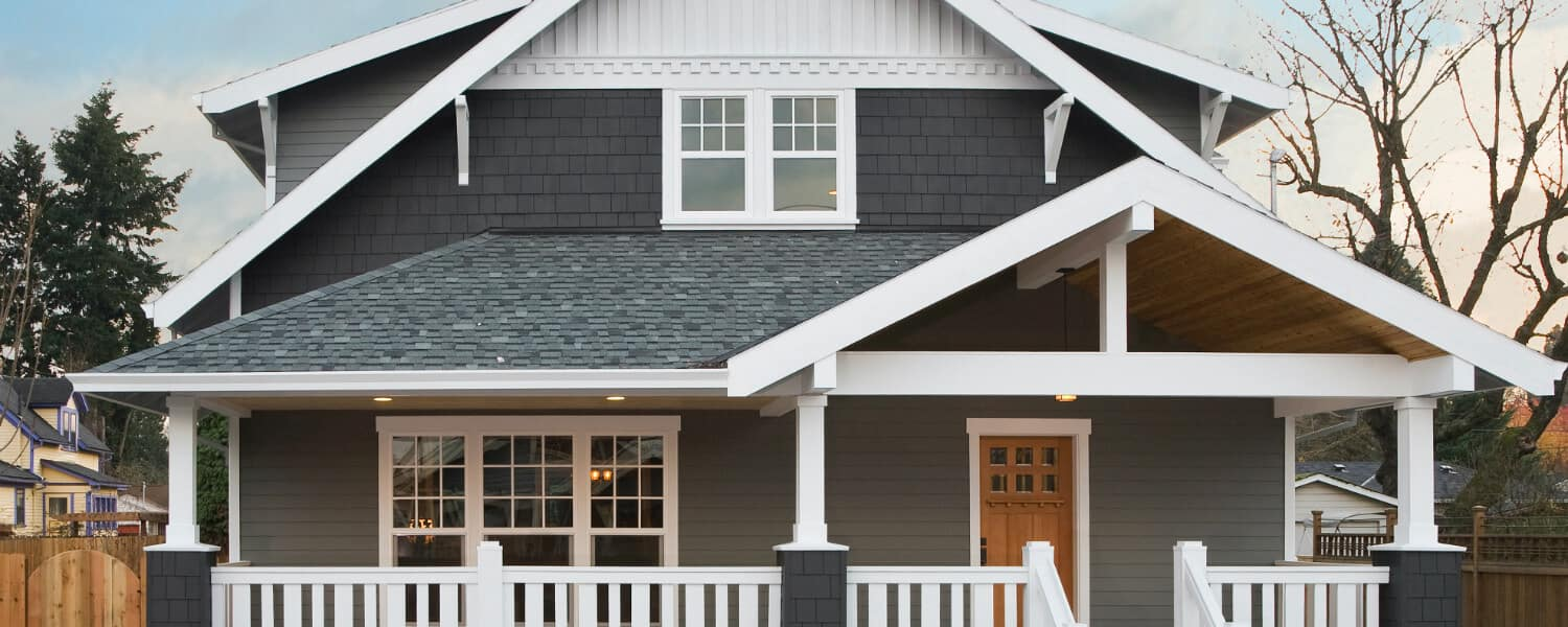 craftsman home trends - charcoal house with unfinished wood door