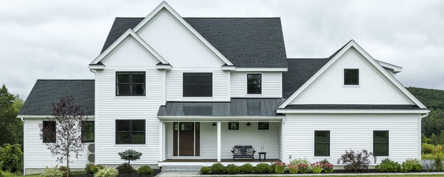 farmhouse trends - white house with charcoal roof