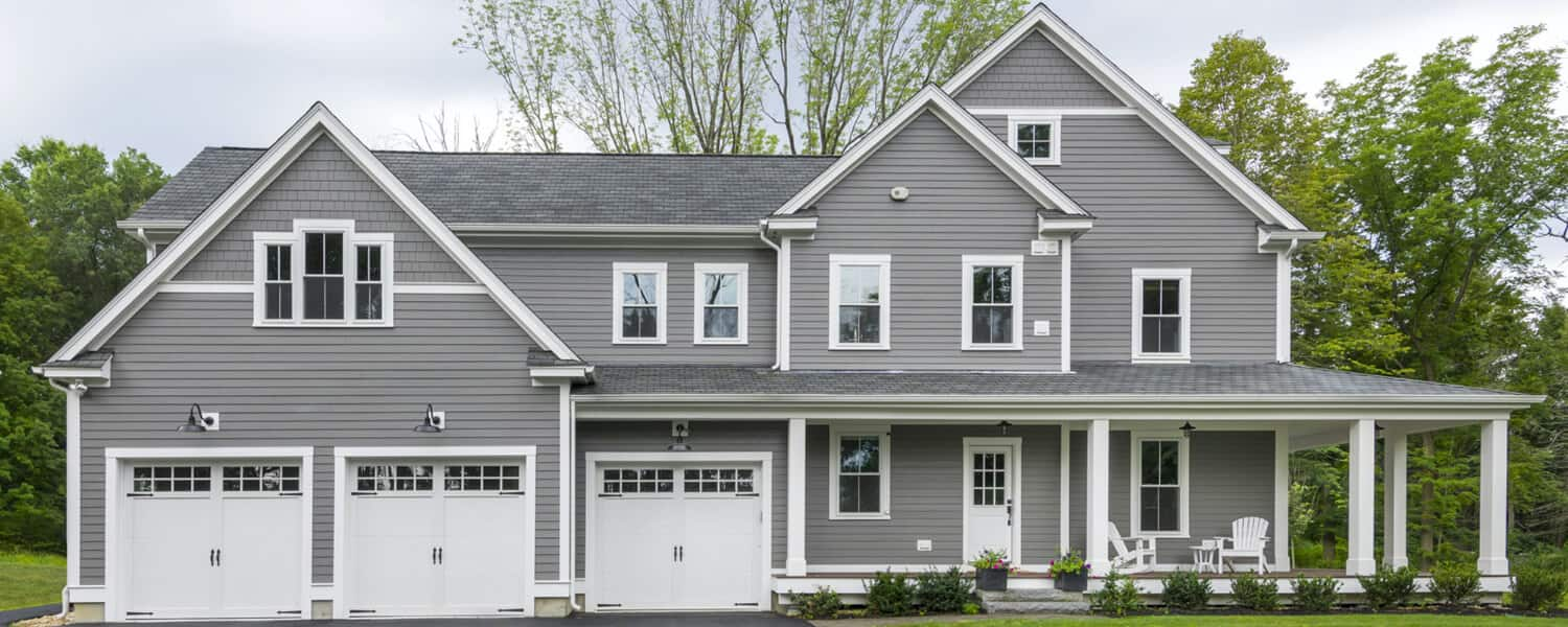 farmhouse trends - gray house with gray roof