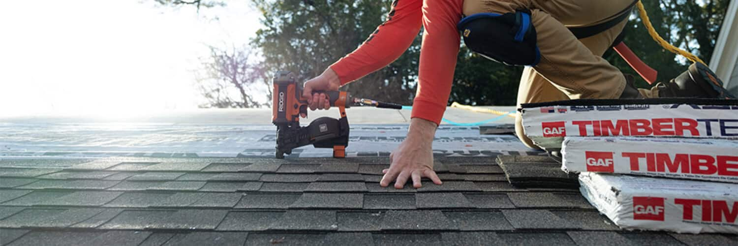 Project Guides image - pro roofer on roof installing shingles