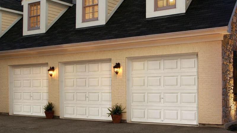 house with 3 single-door garage