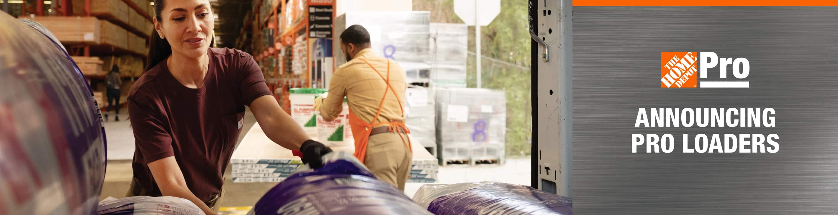 Home Depot associate loading Pro's pickup with building materials
