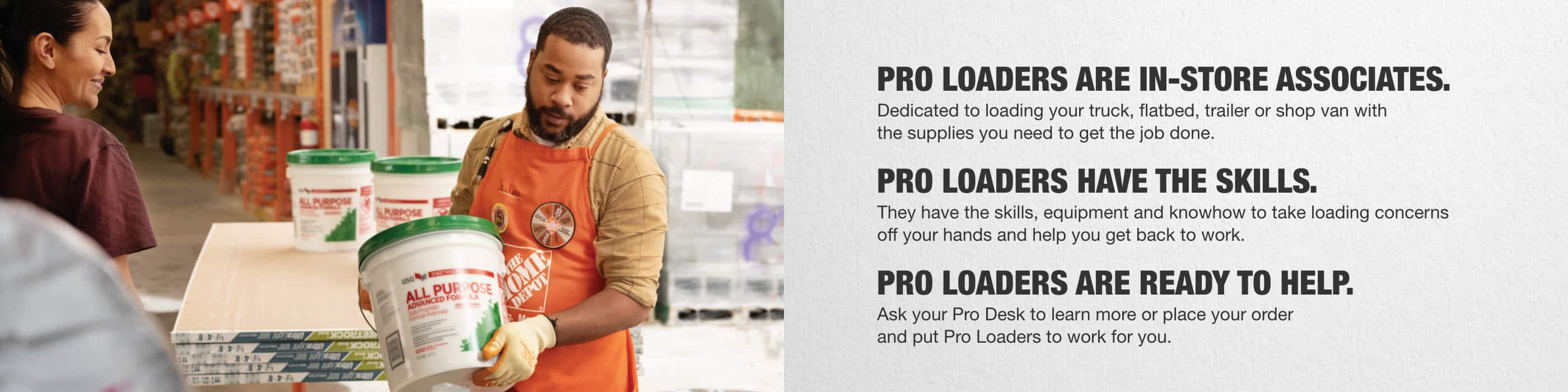 Home Depot associate loading buckets of joint compound onto Pro's pickup