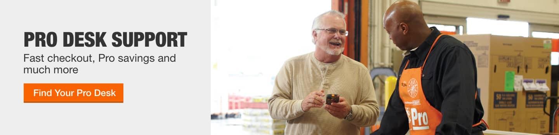 A Home Depot Pro Desk associates helps an in-store customer
