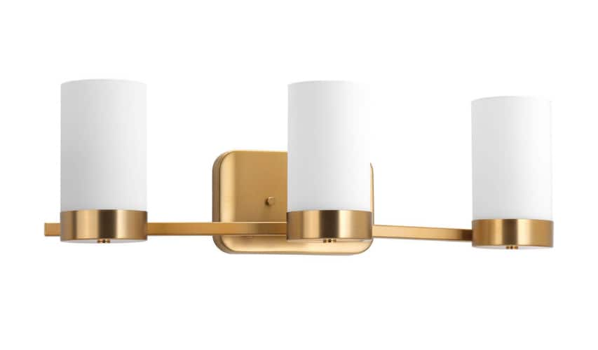 photo of a vanity light with three lights and brass metal finish