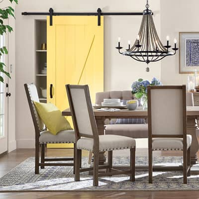 light gray and light blue dining room with canary yellow closet barn door