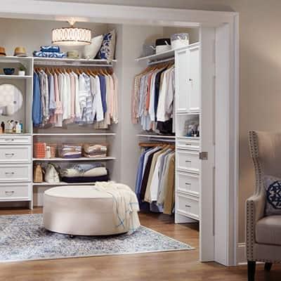 master closet with pocket door slid open