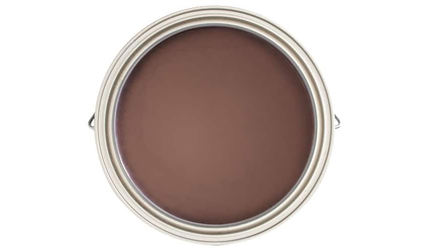 Overhead photo of a paint can with maroon colored paint