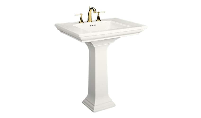 Isolated photo of a white pedestal sink against a white background