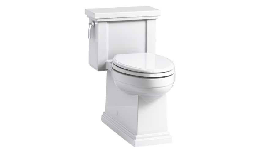 White two piece toilet against a white background